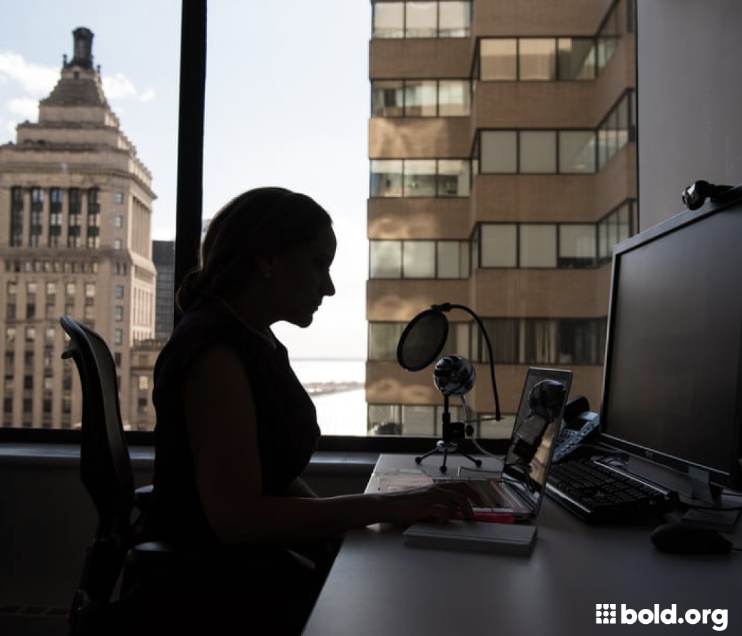 Woman working on a computer at her desk