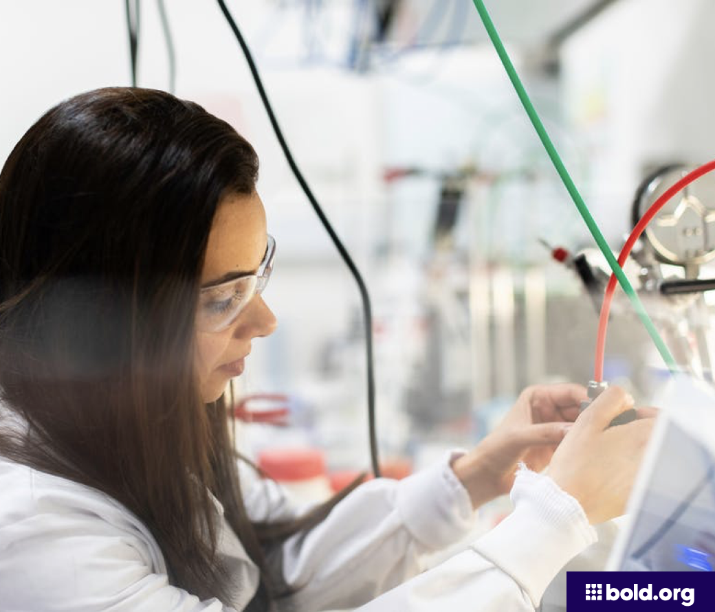Woman in safety glasses working in a lab