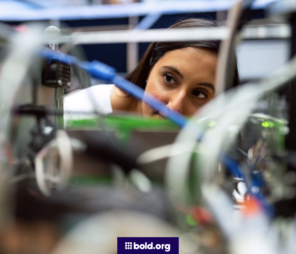 Woman examining the wiring in a lab
