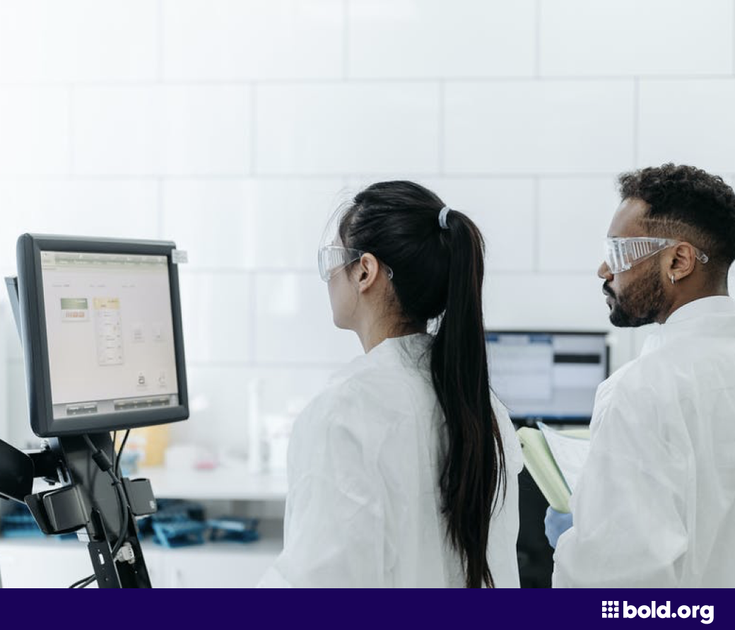 Woman and man looking at a computer in a lab
